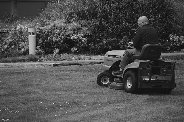 old man on riding lawn mower